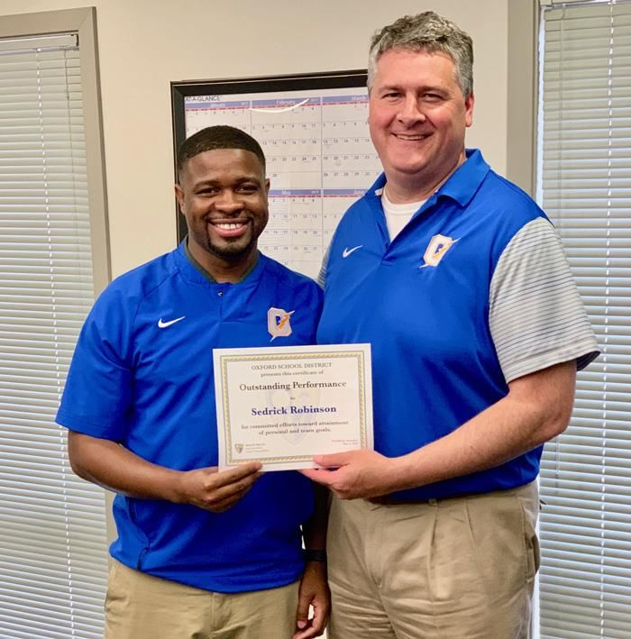 Sedrick Robinson with Superintendent Brian Harvey