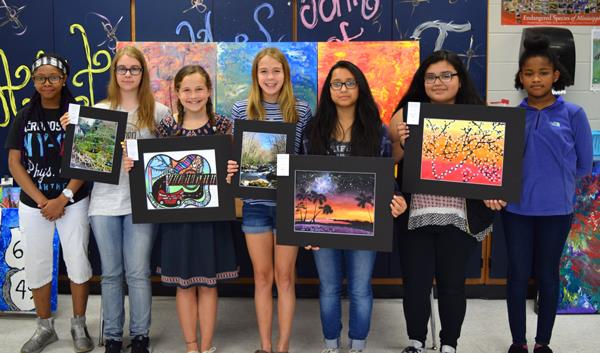 student with their artwork
